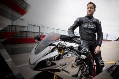 102550-rst-race-dept-v4-1-airbag-one-piece-suit-black-lifestyle-03